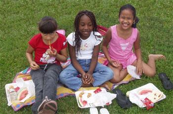 3 girls having lunch in the park