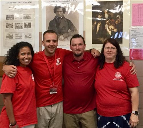 Ms. Amezquita, Mr. Johnson, Mr. Thompson and Ms. Collins wearing Red for Ed!